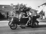 George Sutton and His Family Riding on a 1921 Model T Ford