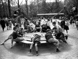 Parisian Children Riding Merry Go Round in a Playground
