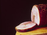 Sliced Ham Revealing It is Stuffed with Liver Pate