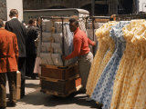 Racks of Dresses Steered by Pushboys in the Garment District