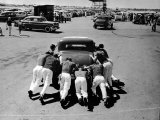 Men Pushing Car During Nat Hot Rod Assoc Drag Meet