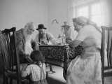 Members of a Jewish Family Sitting Down For a Meal