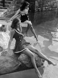Pair of Models Showing Off New Bathing Suits on the Banks of the River