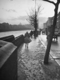 People Walking Through Dublin in the Rain