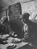 Two Men Eating American Food at a Liverpool Communal Feeding Centre