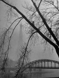 Passerelle Debilly Bridge on a Foggy Winter Day with the Eiffel Tower in the Background