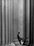 Student Leaning Against Ionic Columns at Entrance of Main Building at MIT