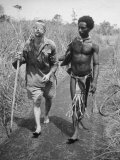 Papuan Native Helping a Wounded Australian Infantryman Along Road Away from the Buna Battlefront