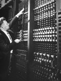 Technician Manipulating 1 of Hundreds of Dials on Panel of IBM's Room Size Eniac Computer