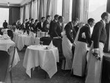 Waiters in the Grand Hotel Dining Room Lined Up at Window Watching Sonja Henie Ice Skating Outside Papier Photo par Alfred Eisenstaedt