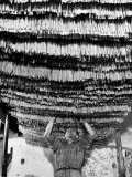 Worker at Pasta Factory Inspecting Spaghetti in Drying Room Reproduction d'art par Alfred Eisenstaedt