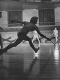 Young People Enjoying a Game of Badminton Inside of a YMCA
