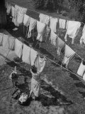 Mother Hanging Laundry Outdoors During Washday Papier Photo par Alfred Eisenstaedt