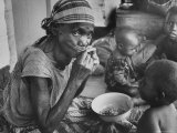 Mother and Starving Children Eating