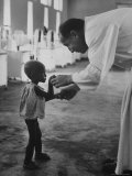 Roman Catholic Priest Chatting with Healing Child