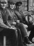 Old Men Smiling  Sitting on Bench  After Waiting in Line For Meat