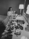 Mrs Ottilie King Lining Up Her Children's Shoes