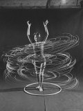 Multiple Exposure of a Woman Playing with a Hula Hoop