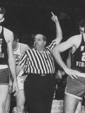 Referee Jim Enright Calling Plays and Using Hand Signals During a Game