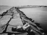 Senator Edward M Kennedy Taking a Sunbath on Breakwater Near His Summer Home