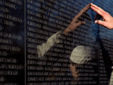 Hand Touches and is Reflected in the Vietnam Veterans Memorial
