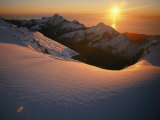 Sunset Glow over a Snowy Mountain Face