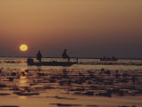 Fishermen Take in the First Rays of the Rising Sun on Lake Okeechobee