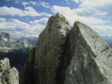 A Climber Standing at the Top of a Mountain in the Dolomites  Italy