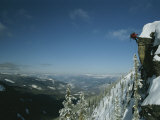 Rappeling with Snowboard  Red Mountain  British Columbia