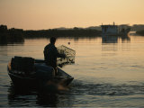 Fisherman in Boat Emptying His Crab Trap
