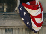An American Flag Draped Through an Open Barn Window