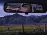 An Old Truck and Barn are Reflected in a Rear-View Mirror