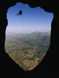 A Man Rappelling to His Bivouac on the East Face of Poi