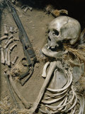 The Sun-Bleached Bones of Gunslinger Lie Next to His Revolver in Ghost Town in Northwest Wyoming