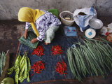 A Woman Sells Vegetables at an Open-Air Market in Malaysia