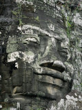 A Serene Likeness of Buddha Sculpted of Stone Peers from a Temple Wall