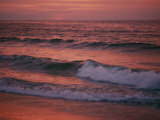 The Rising Sun Creates Beautiful Colors on the Waves