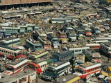 Buses Fill a Parking Lot