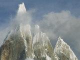 The Summit of Cerro Torre Massif Rises Through the Clouds