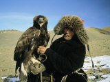 A Kazakh Eagle Hunter Poses with His Eagle on a Plain in Kazakhstan