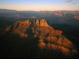 Low Sunlight Shines on Mountains Outside of St George  Utah; Zion National Park is in the Distance