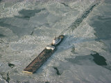 Tugboat Pushing Barge Through Winter Ice on the Chesapeake Bay