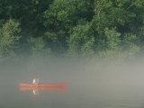 Man Paddling Canoe in Mist  Roanoke River  North Carolina