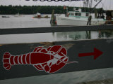A Lobster Sign Backed by a Lobster Boat on Casco Bay