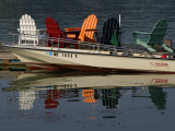 Peaceful Reflections of Colorful Chairs in the Waters of Casco Bay
