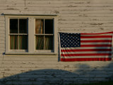 Evening Light on an American Flag on the Side of an Old Barn