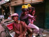 Group on Rickshaw Celebrating Holi Festival  Delhi  India