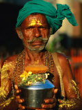 Pilgrim with Offerings to Give to Deities at Sri Meenakshi Temple  Madurai  India