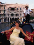 Woman in Gondola in Front of Ca'D'Oro in Grand Canal  Venice  Veneto  Italy