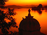 Silhouette of Domed Building on Shore of Lake Pichola at Sunset  Udaipur  Rajasthan  India